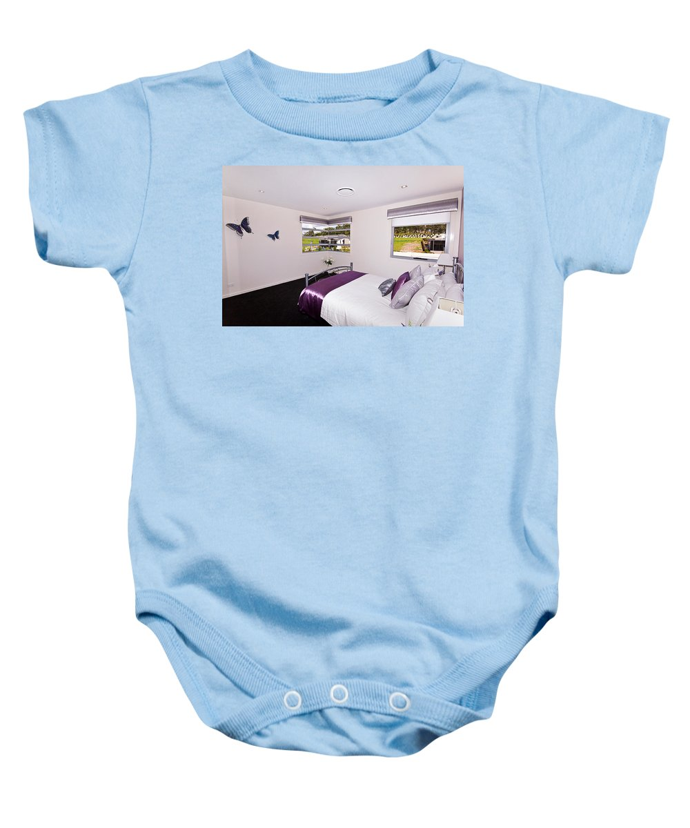 Cute Baby Onesie featuring the photograph Cute Girl's Bedroom by Darren Burton