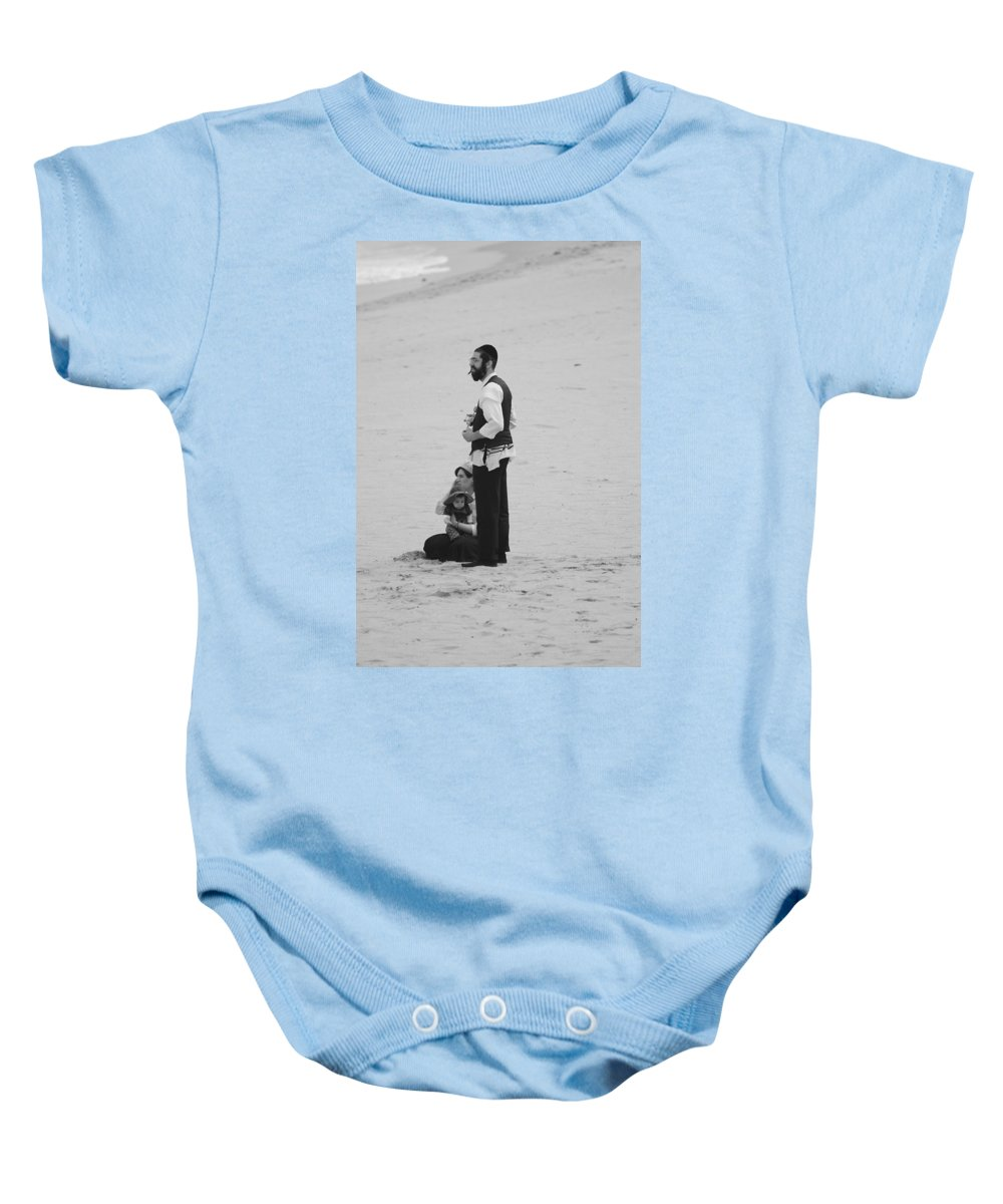 Black And White Baby Onesie featuring the photograph Family Beach Day by Rob Hans