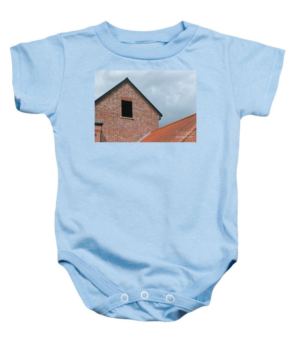 Brick Baby Onesie featuring the photograph Grey Skyline by Ann Horn