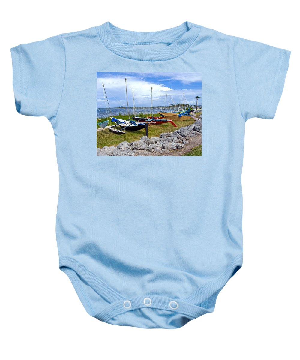 Sail; Sailing; Boat; Sailboat; Mast; Plywood; Homemade; Boy; Scouts; Fleet; Class; Dragon; Tiller; F Baby Onesie featuring the photograph Homemade Outriggers Canoes On The Indian River Lagoon In Florida by Allan Hughes