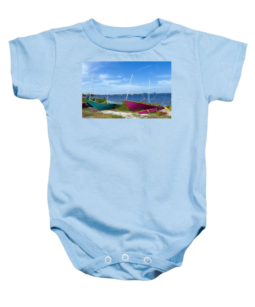 Sail; Sailing; Boat; Sailboat; Mast; Plywood; Homemade; Boy; Scouts; Fleet; Class; Dragon; Tiller; F Baby Onesie featuring the photograph Indian River Lagoon On The Easr Coast Of Florida by Allan Hughes