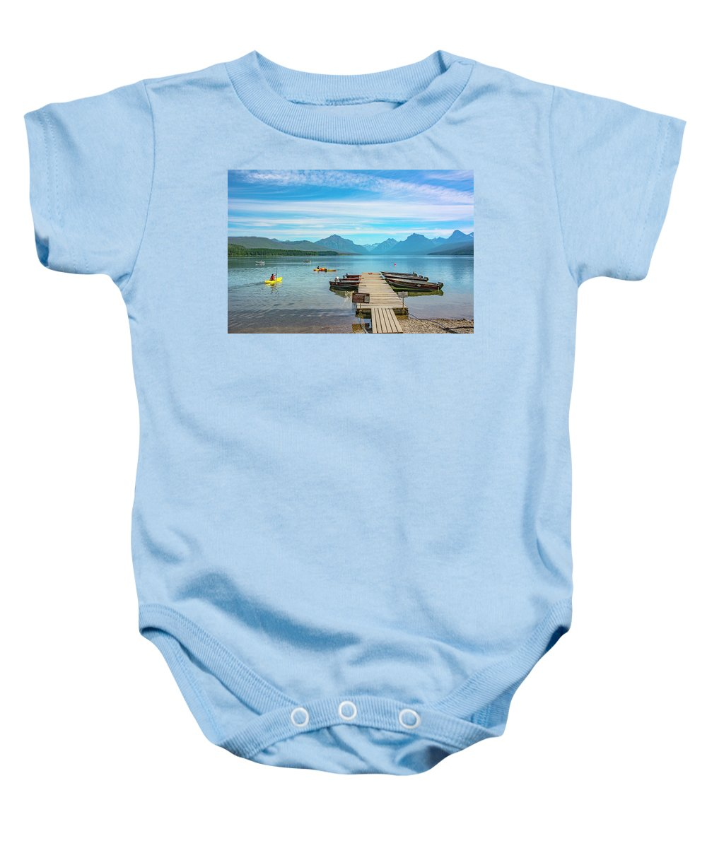 Montana Baby Onesie featuring the photograph July 4th on Lake McDonald by Bryan Spellman