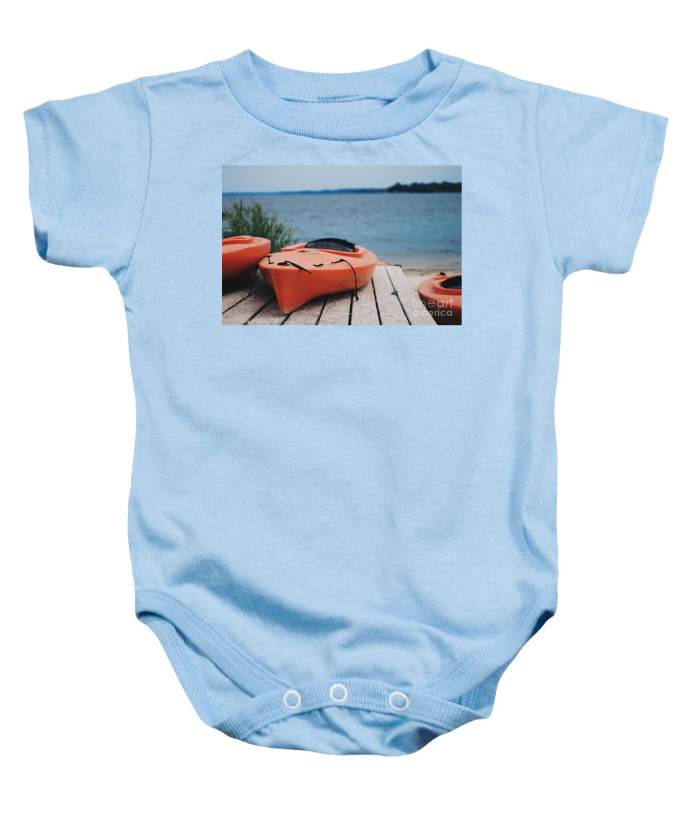 Kayaks By The Water Baby Onesie featuring the photograph Kayaks by Avery Strand