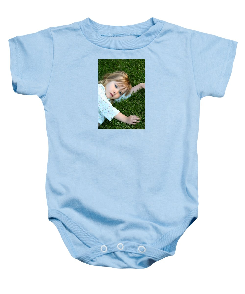 Girl Baby Onesie featuring the photograph Lying In The Grass by Margie Wildblood