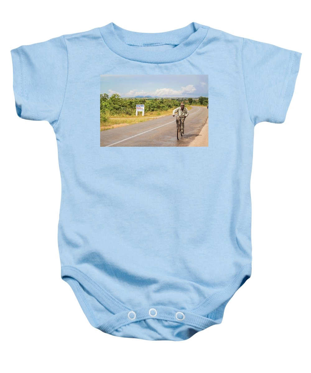 Man Baby Onesie featuring the photograph Man On Bicycle In Zambia by Marek Poplawski