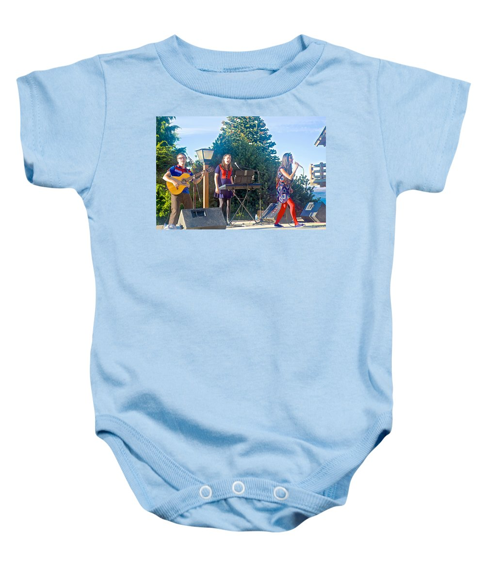 Musical Entertainers In Central Park In Bariloche Baby Onesie featuring the photograph Musical Entertainers In Central Park In Bariloche-argentina by Ruth Hager