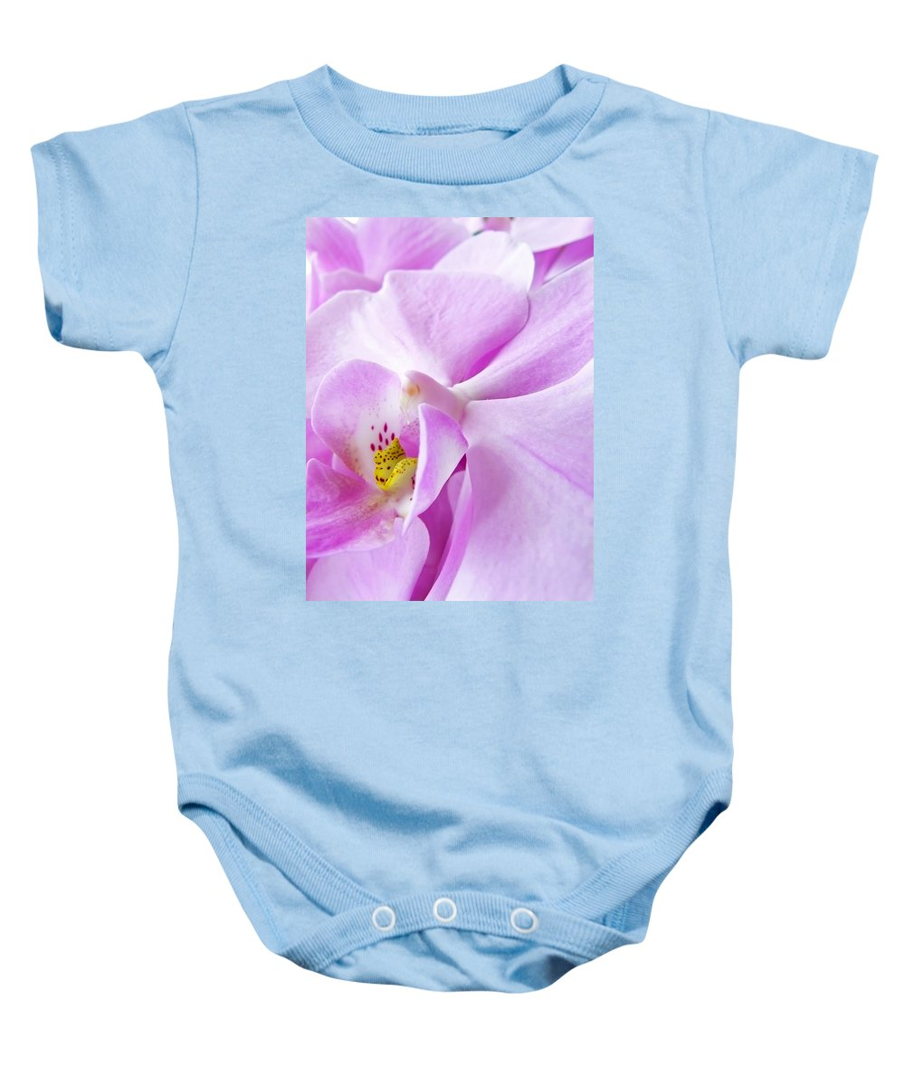Orchid Baby Onesie featuring the photograph Orchid by Daniel Csoka