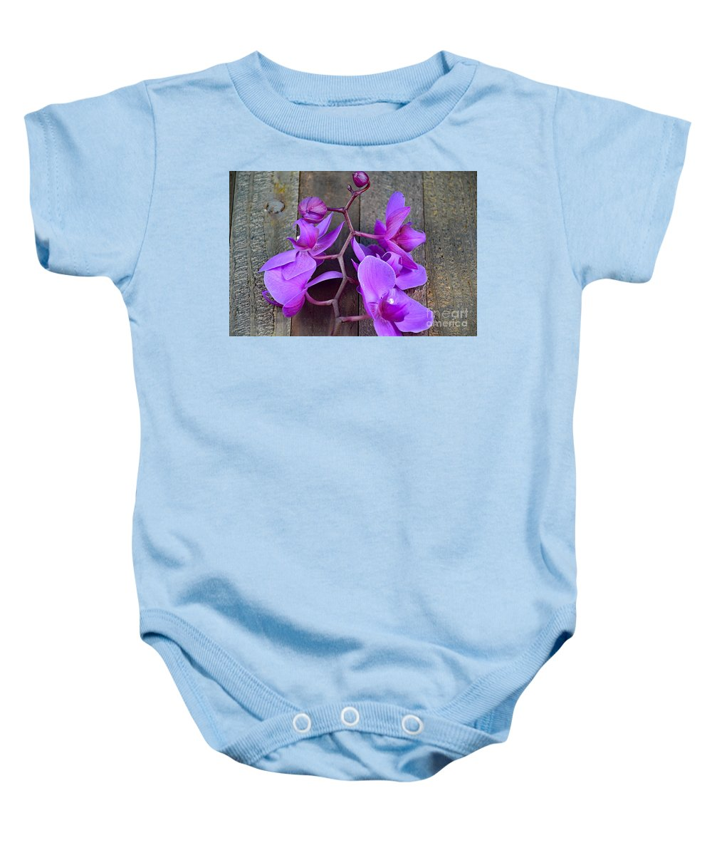 Orchid Baby Onesie featuring the photograph Orchid by Ray Shrewsberry