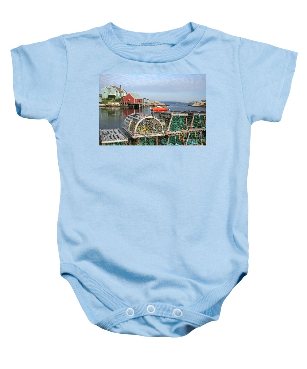 Peggy\\ Baby Onesie featuring the photograph Peggys Cove And Lobster Traps by Thomas Marchessault