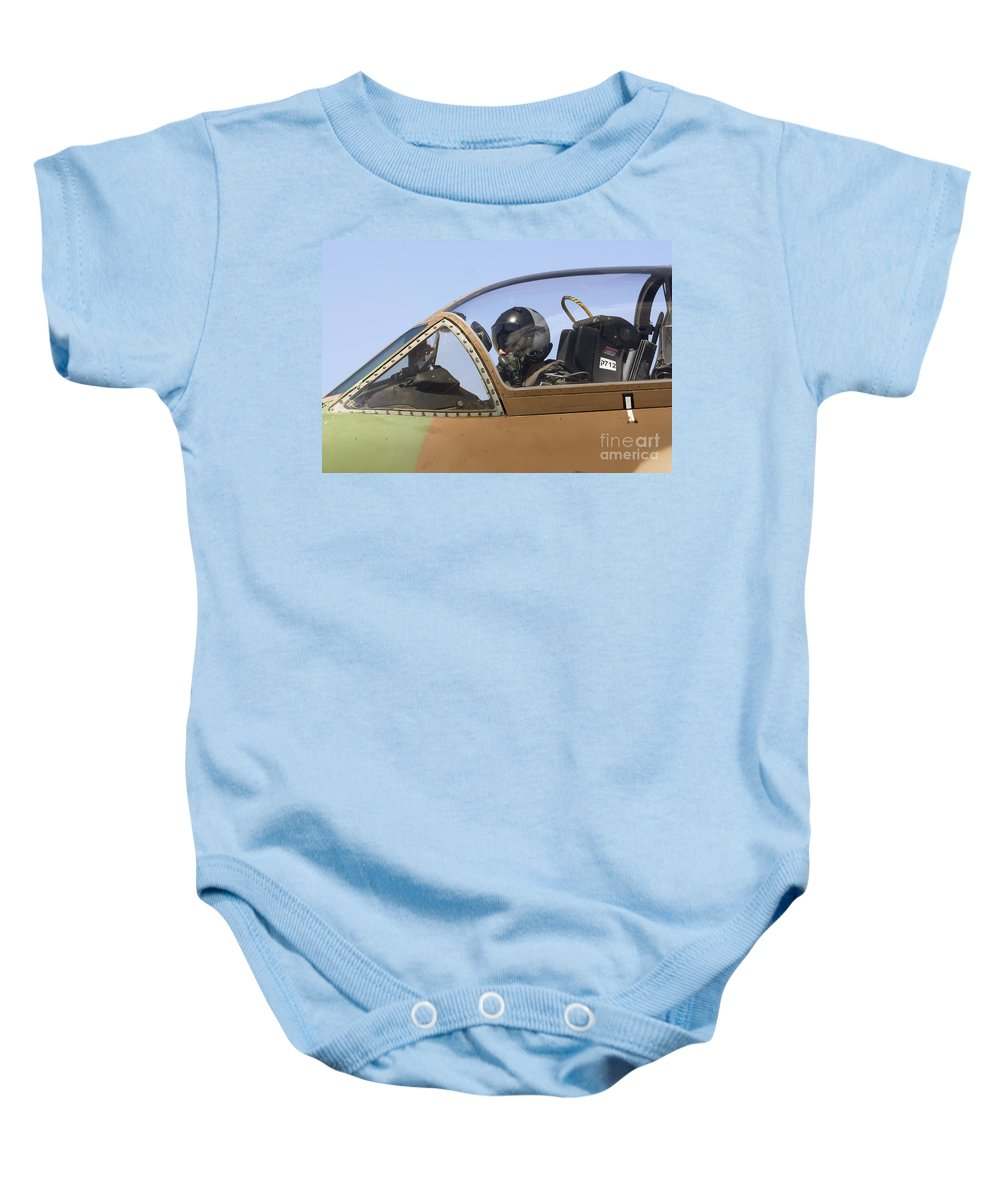 Aircraft Baby Onesie featuring the photograph Pilot In The Cockpit Of A Skyhawk Fighter Jet by Nir Ben-Yosef