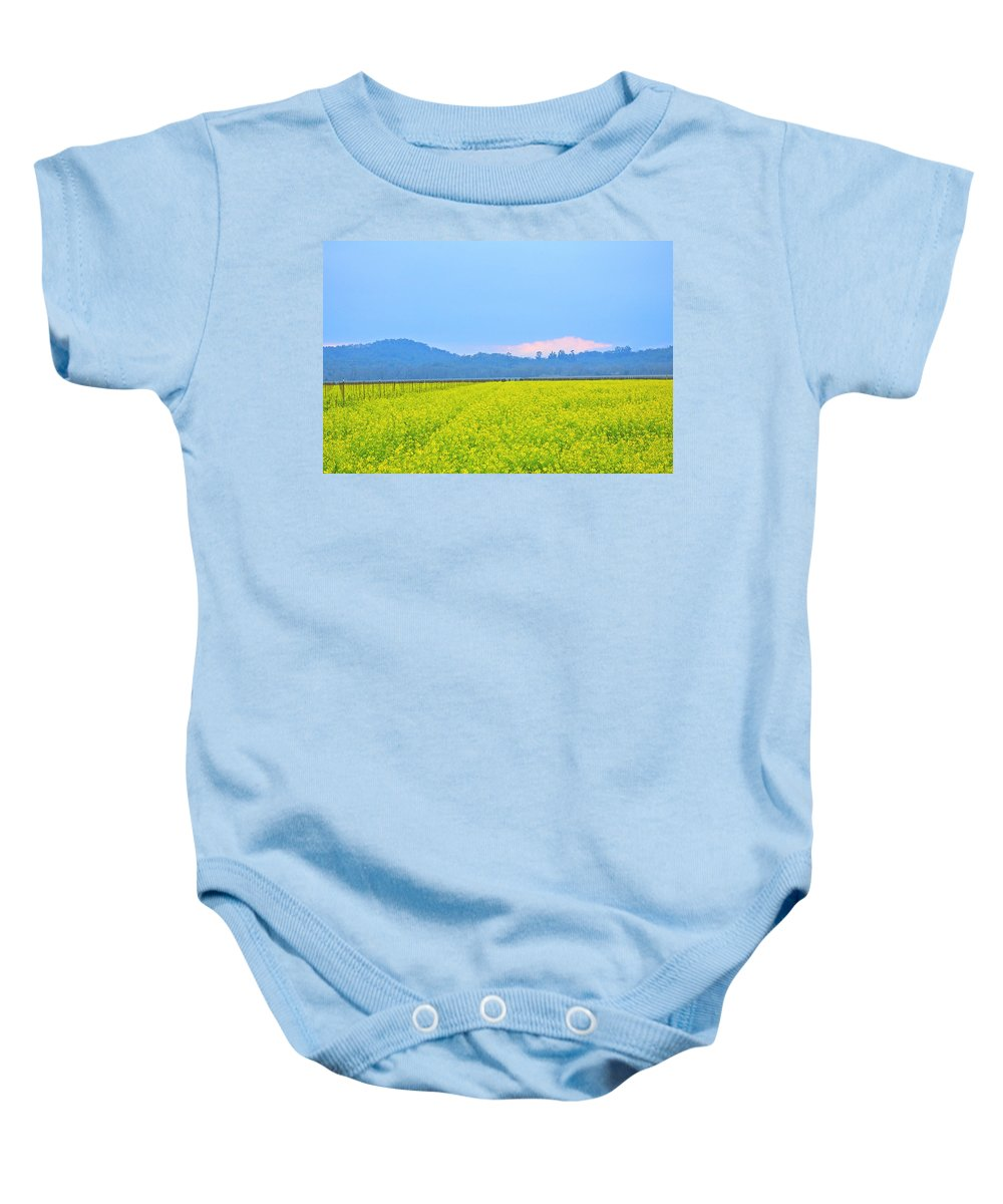 Mustard Baby Onesie featuring the photograph Pink Cloud Over The Mustard Fields by Tom Reynen