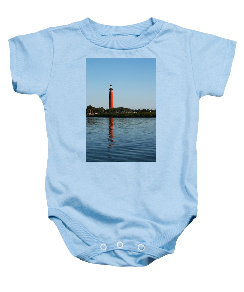 Lighthouse Tall Red Water Reflection Fl Sky Blue Wave Ripple Inlet Travel Tourist Vacation Baby Onesie featuring the photograph Ponce Inlet Lighthouse by Andrei Shliakhau