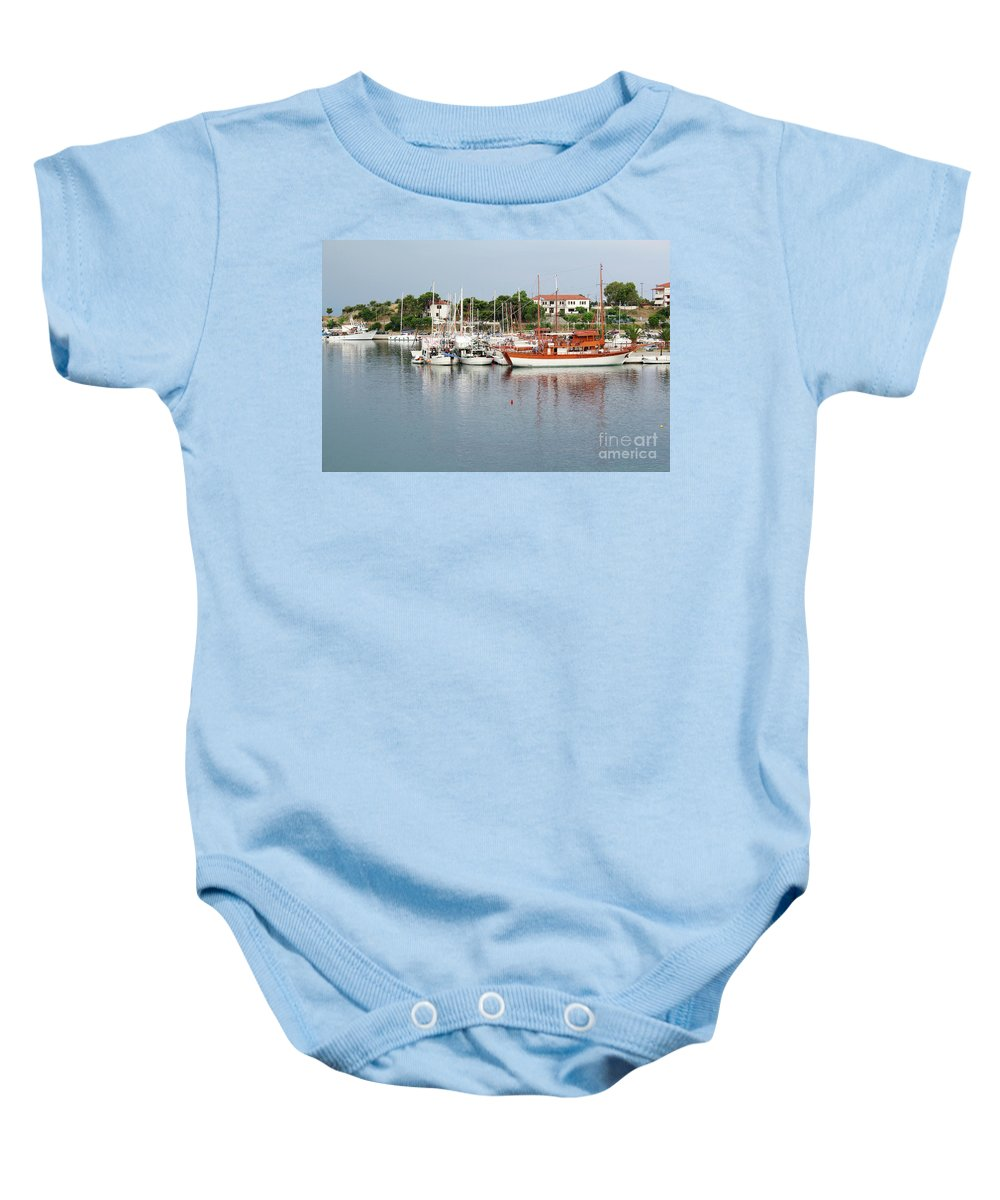 Ship Baby Onesie featuring the photograph Port With Sailboat And Fishing Boat by Goce Risteski