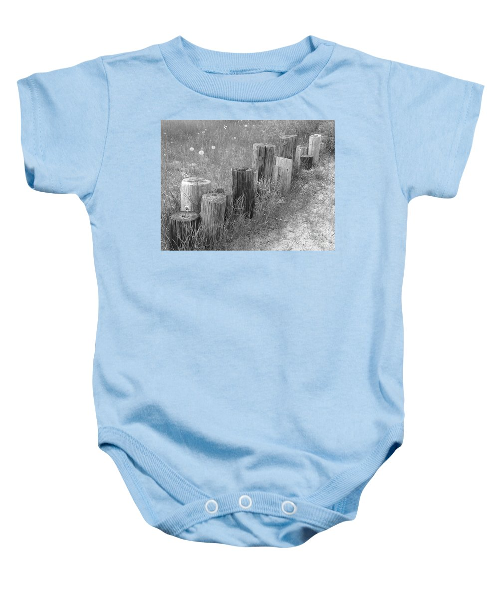 Black And White Photo Of Cut Down Fence Posts Baby Onesie featuring the photograph Posts In A Row by Erick Schmidt