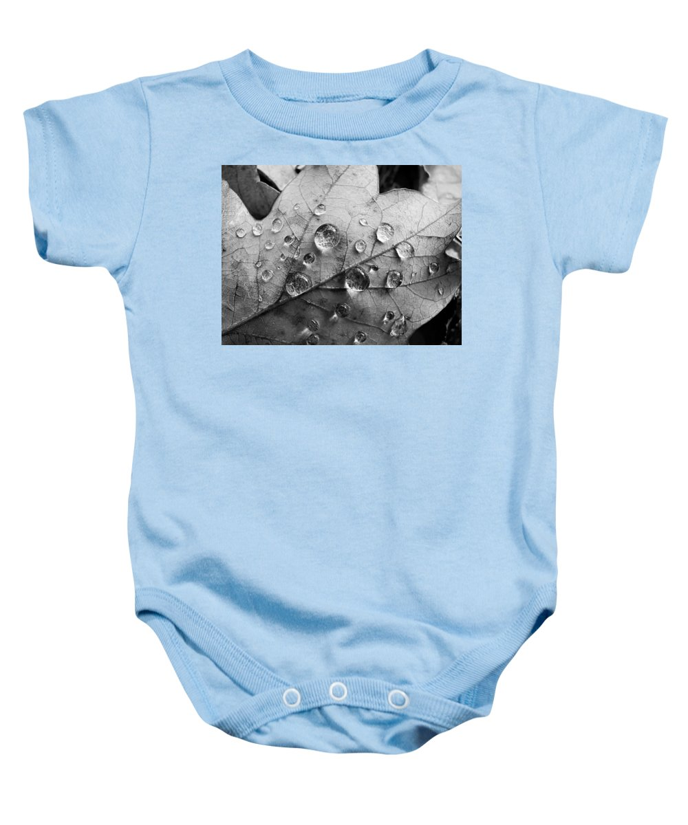 Drops Baby Onesie featuring the photograph Raindrops by Daniel Csoka