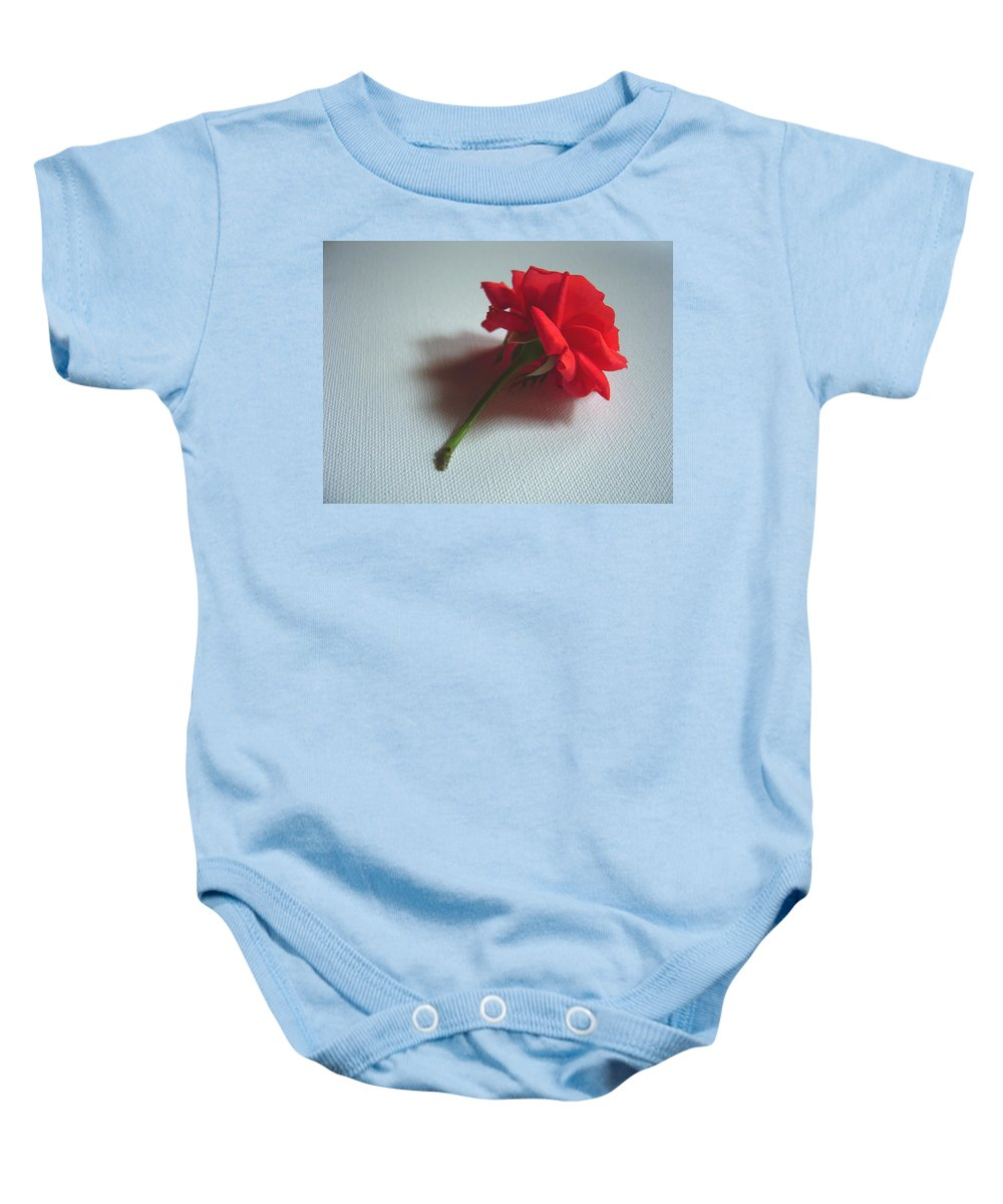 Red Baby Onesie featuring the photograph Red Rose Plucked by Usha Shantharam