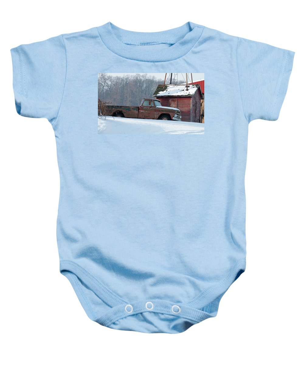 Truck Baby Onesie featuring the photograph Red Truck In The Snow by David Arment
