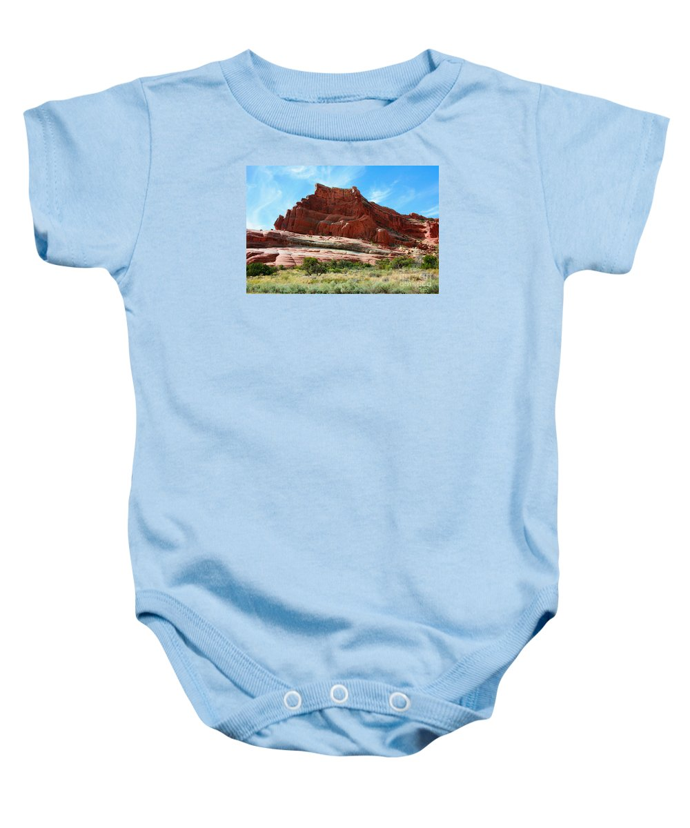 Arches National Park Baby Onesie featuring the painting Rock Formation Of La Sal Mountains by Corey Ford