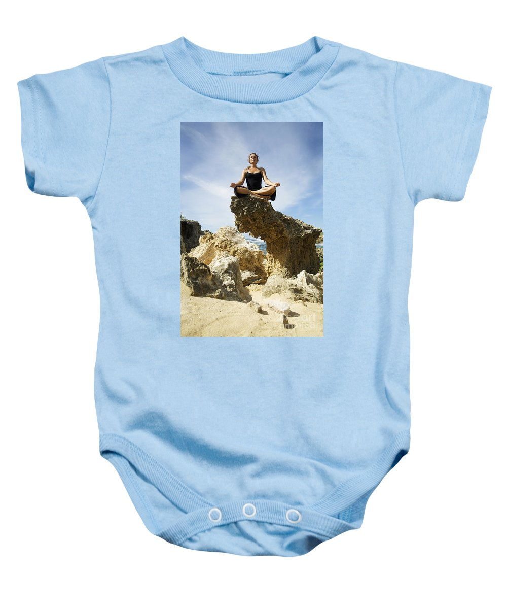 Attract Baby Onesie featuring the photograph Rocky Yoga by Kicka Witte - Printscapes