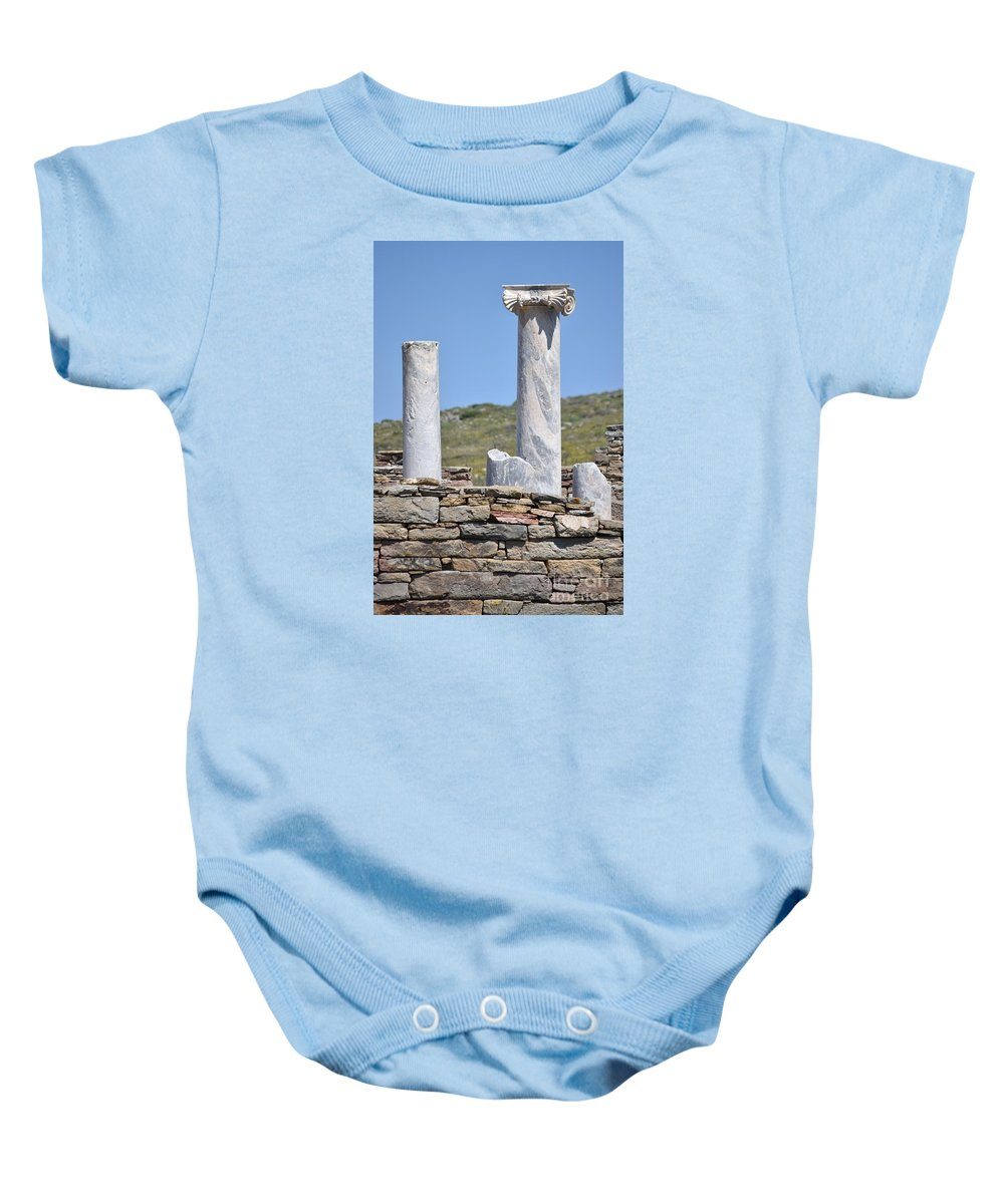 Stone Baby Onesie featuring the photograph Ruins Of Delos by Eric Reger