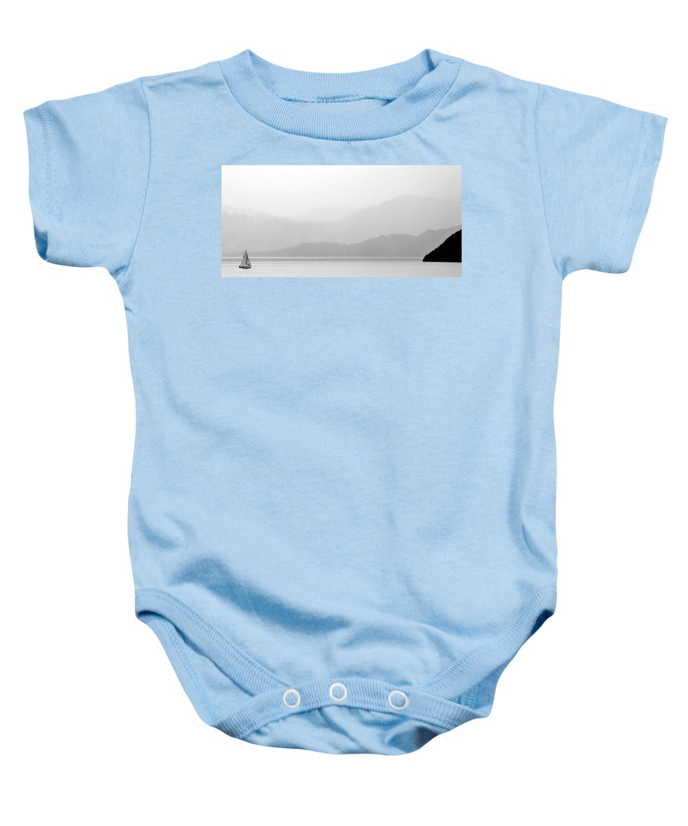 Misty Baby Onesie featuring the digital art Sailboat On New Zealands Cook Strait by Mark Duffy