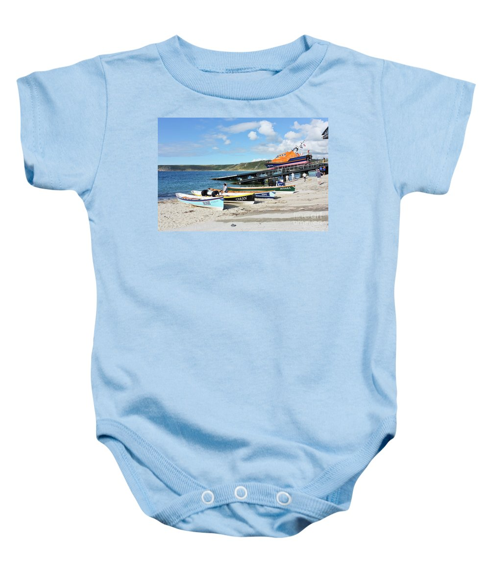 Land\'s End Baby Onesie featuring the photograph Sennen Cove Lifeboat And Pilot Gigs by Terri Waters