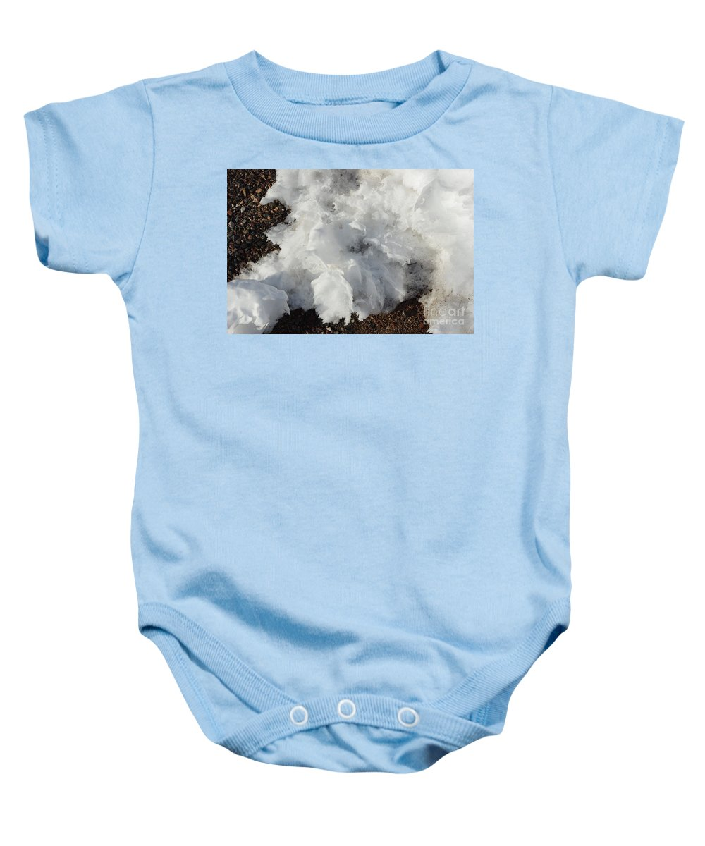 Snow Baby Onesie featuring the photograph Snow Melting Shapes by Alice Markham