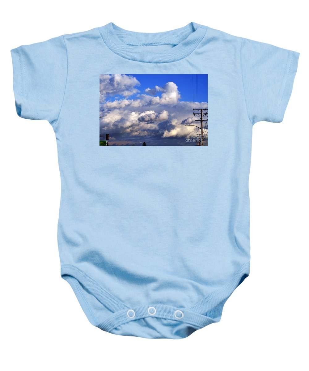 Clay Baby Onesie featuring the photograph Strange Clouds by Clayton Bruster