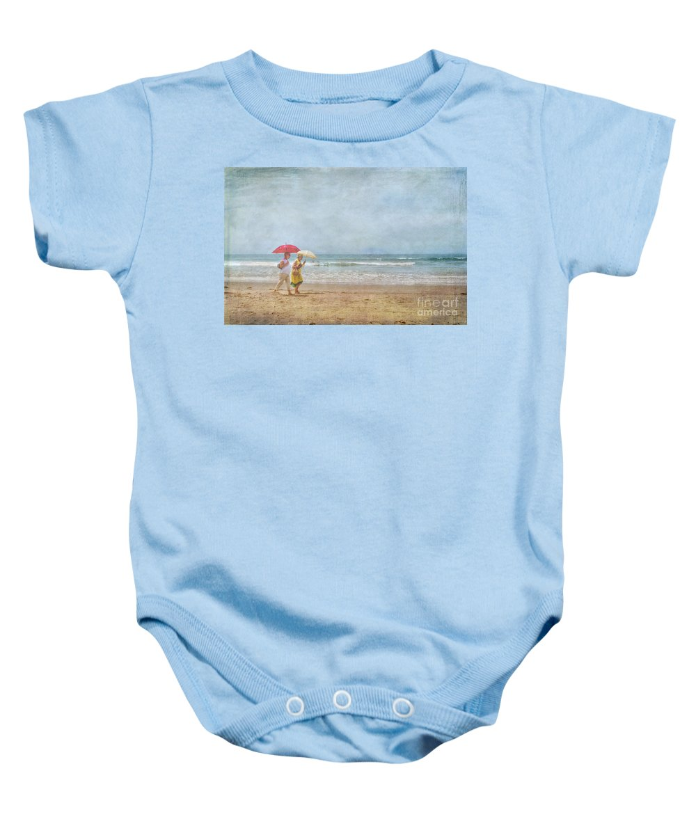 Two Elderly Women Strolling On Beach Shaded By Colorful Umbrellas Baby Onesie featuring the photograph Strolling On The Beach by David Zanzinger