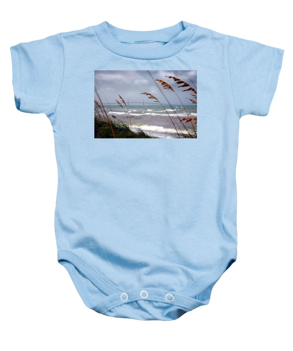 Sunshine Baby Onesie featuring the photograph Sunshine Skyway Bridge Viewed From Fort De Soto Park by Mal Bray