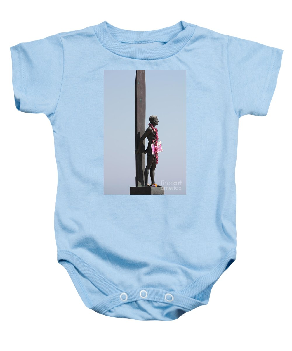 Surfer Statue Baby Onesie featuring the photograph Surfer Statue by Carol Groenen