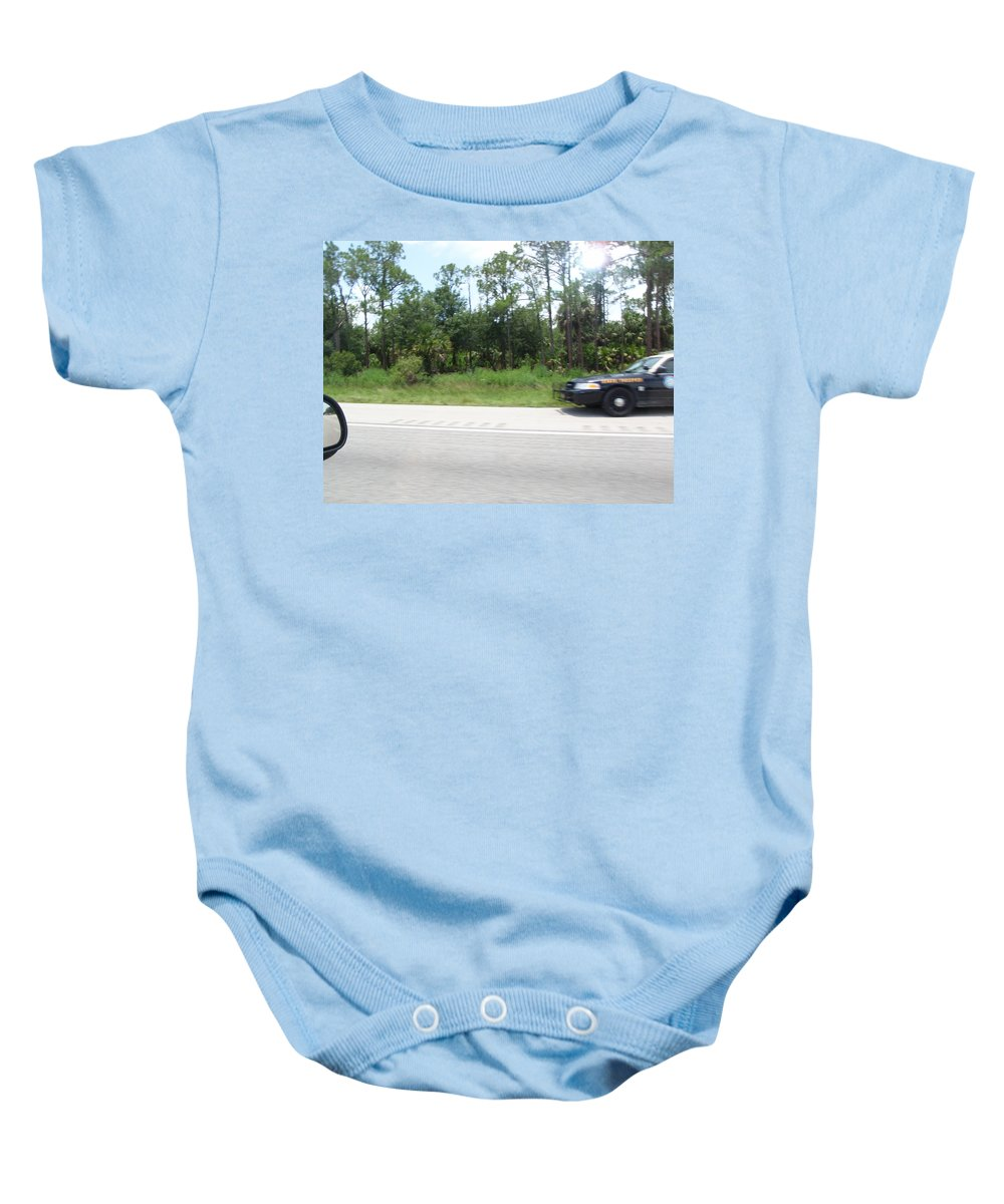 Getaway Baby Onesie featuring the photograph The Getaway by Are Lund