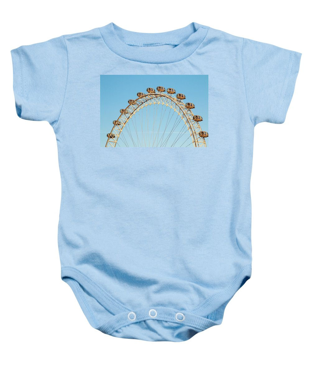 London Eye Baby Onesie featuring the photograph The London Eye Ferris Wheel Against A Cold Blue Winter Sky by Chris Warham