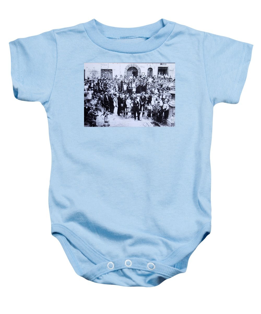 Tuscany Baby Onesie featuring the photograph The Village Band by Kurt Hausmann