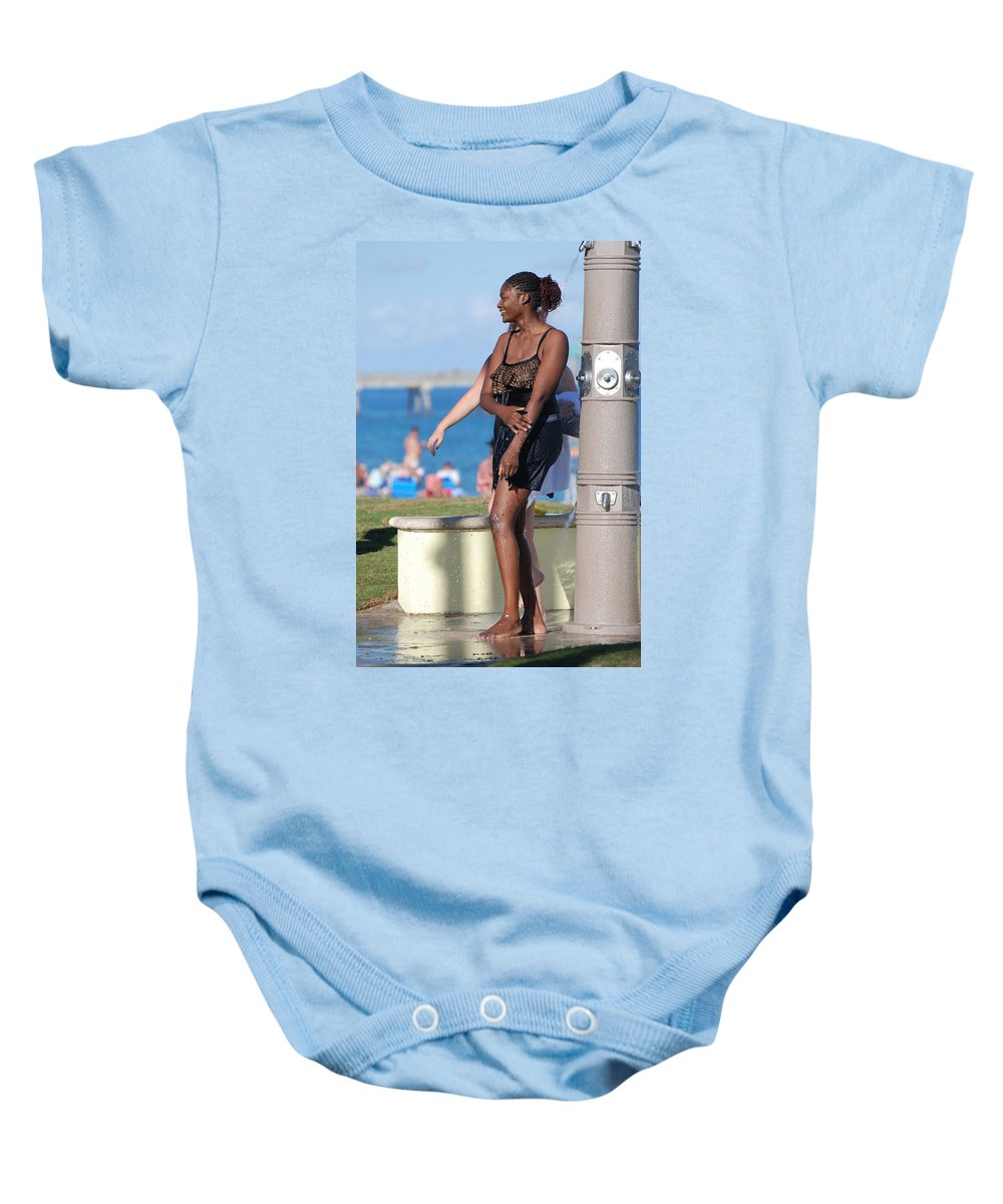 Bathing Suit Baby Onesie featuring the photograph Three Arms At The Shower by Rob Hans