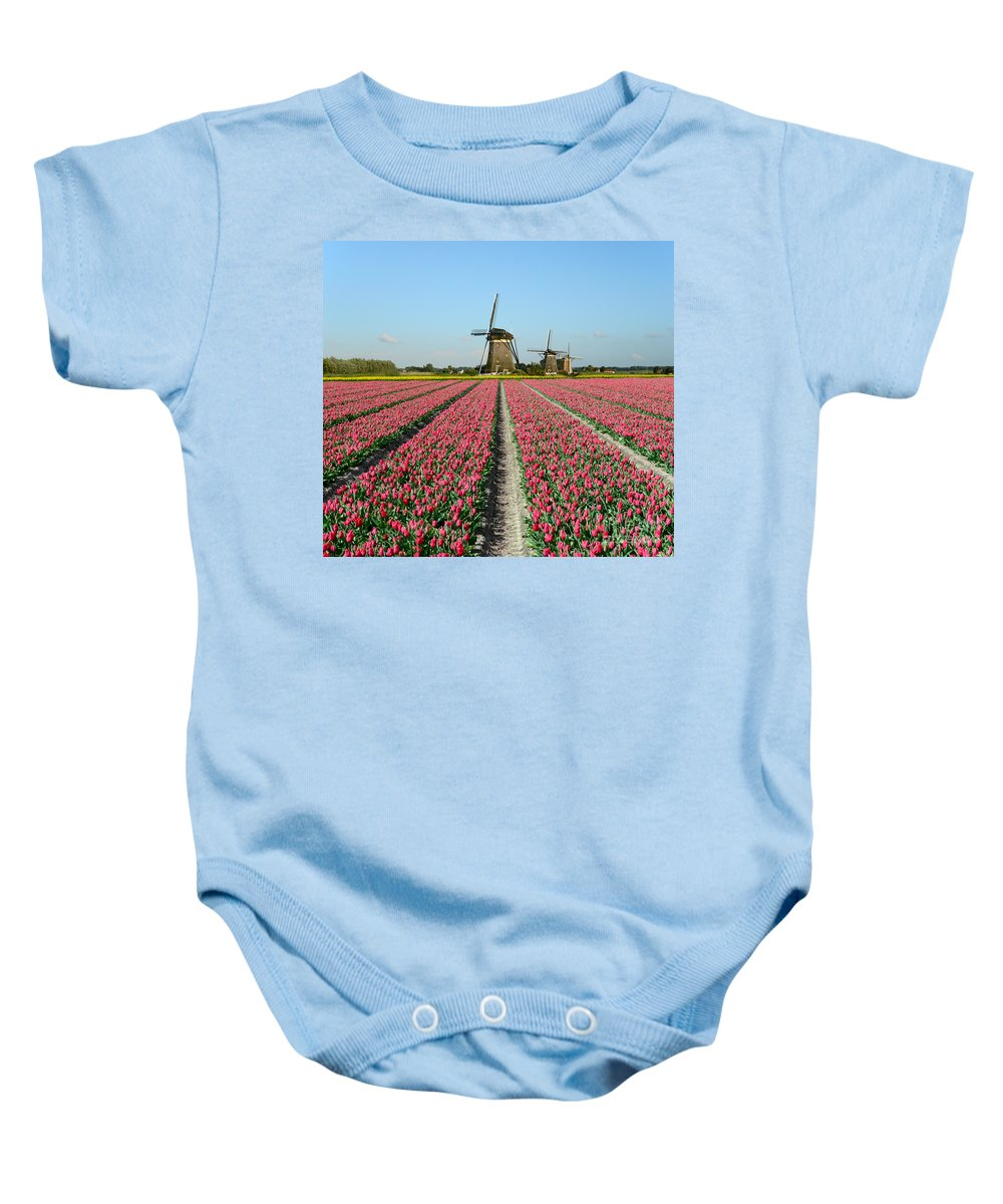 Tulips Baby Onesie featuring the photograph Tulips And Windmills In Holland by IPics Photography