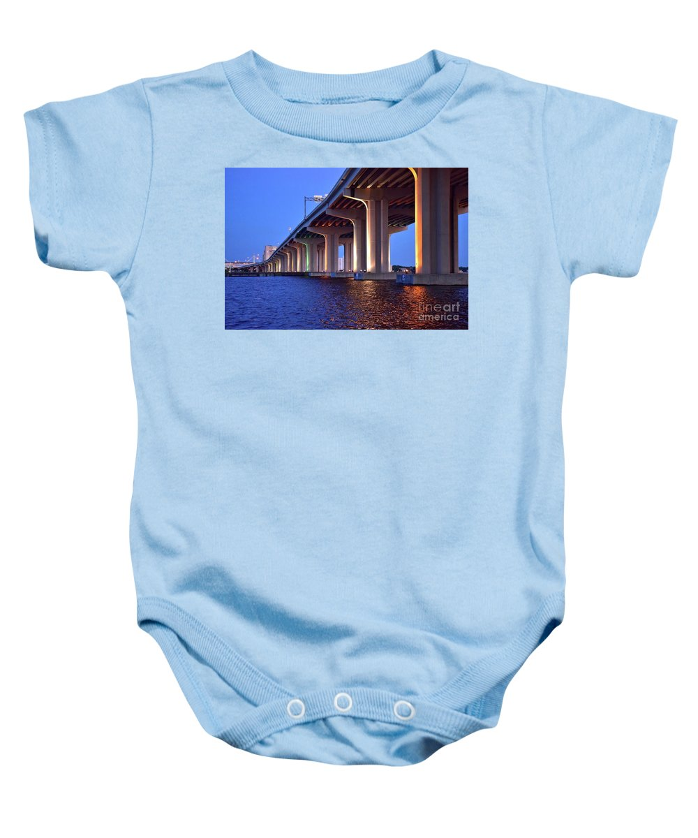 Bridge; Pillars; River; Sky; Interstate; Road; Infrastructure; Sunset; Lights; Dusk; Blue Baby Onesie featuring the photograph Under The Bridge With Lights 01175 by Anna Gibson