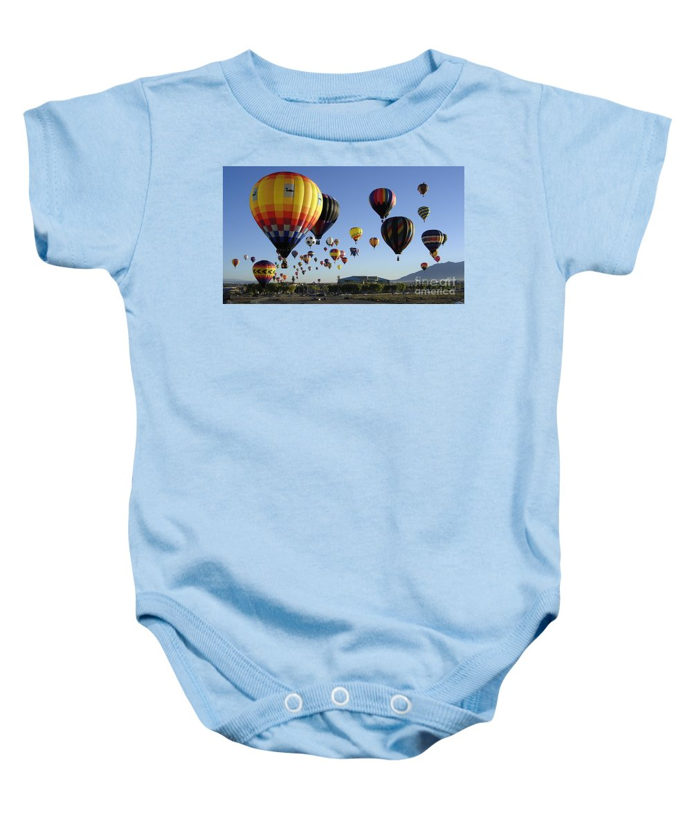 Balloons Baby Onesie featuring the photograph Up And Away by Mary Rogers