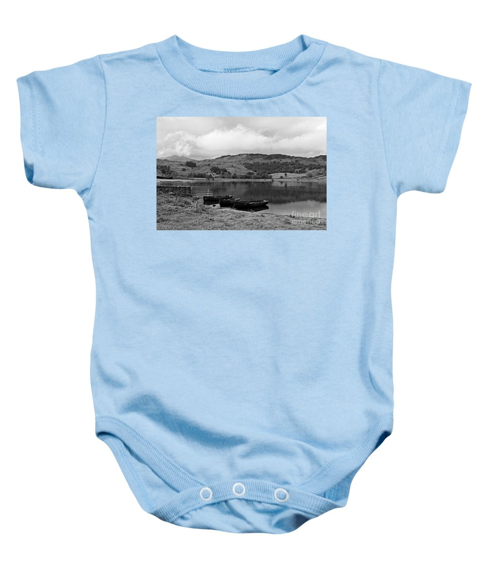 Watendlath Baby Onesie featuring the photograph Watendlath Tarn In The Lake District Cumbria by Louise Heusinkveld