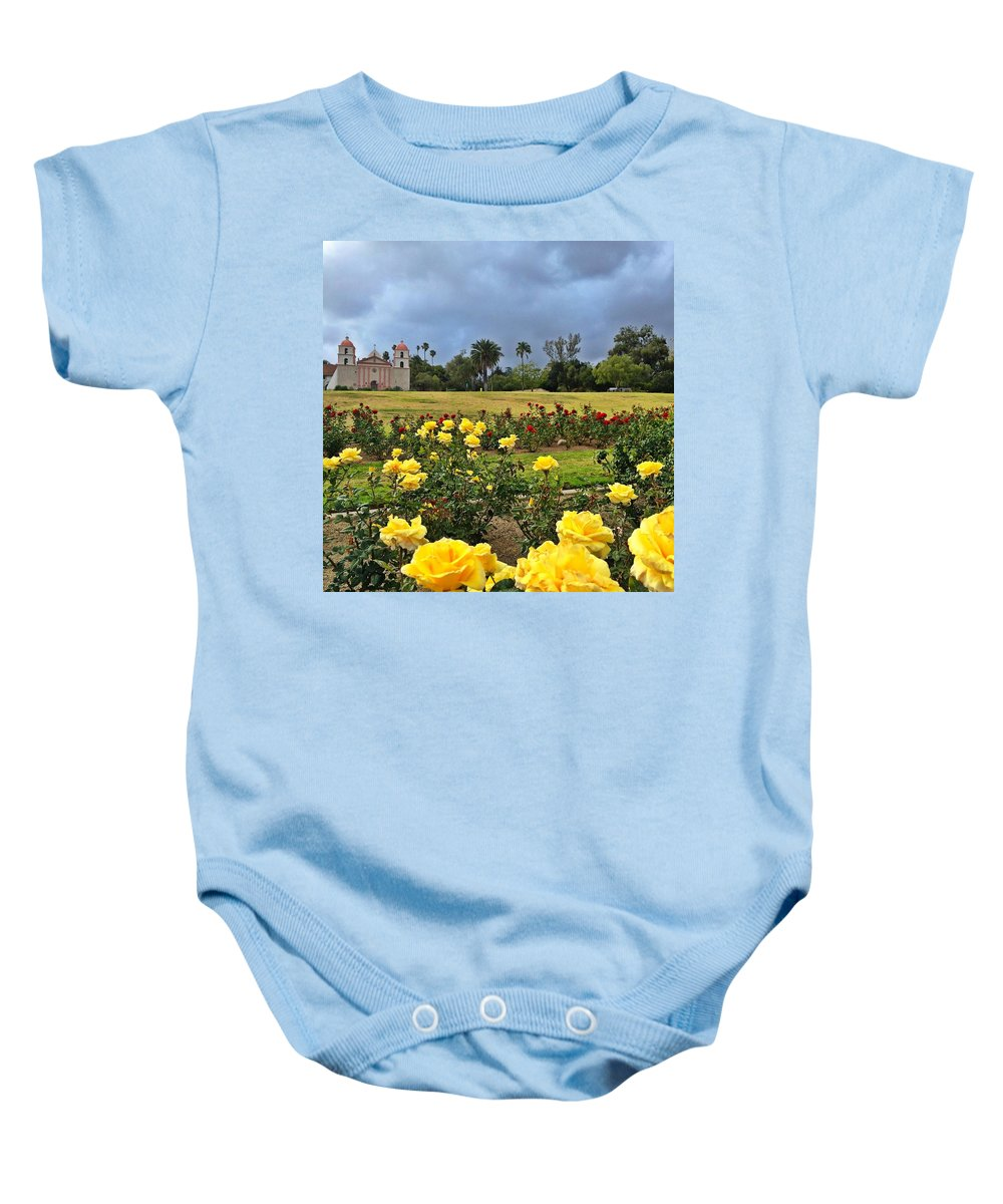 Santa Barbara Mission Baby Onesie featuring the photograph Yellow Roses And Dark Sky by JoJo Brown