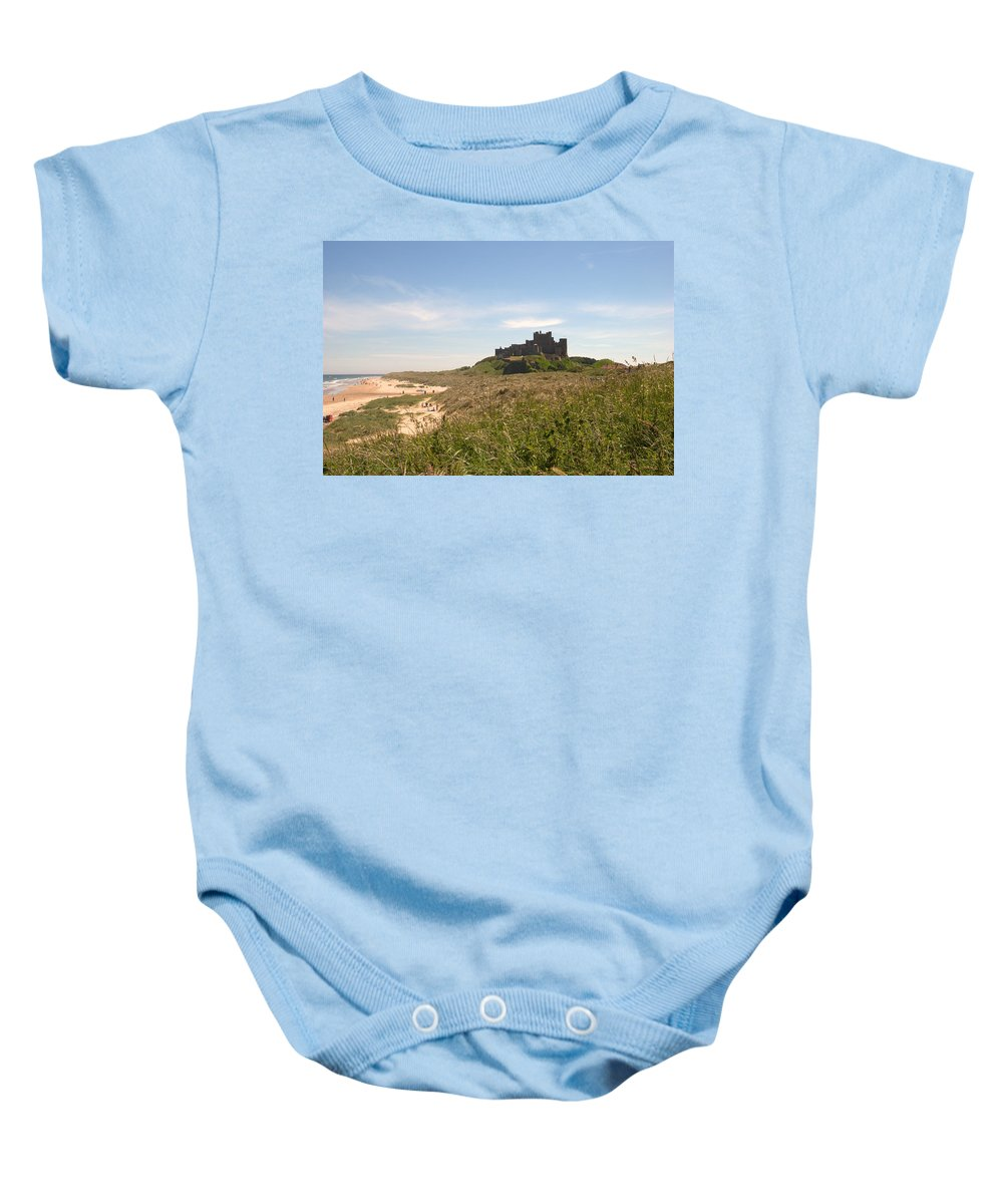 Bamburgh Baby Onesie featuring the photograph Bamburgh Castle And Beach In Summer by Victor Lord Denovan