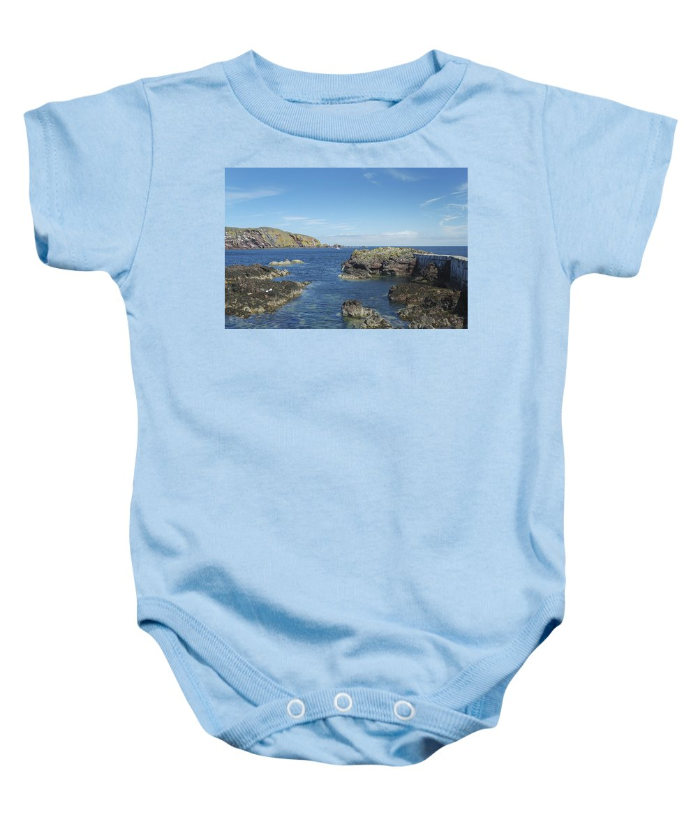 Harbour Baby Onesie featuring the photograph harbour entrance at St. Abbs, Berwickshire by Victor Lord Denovan