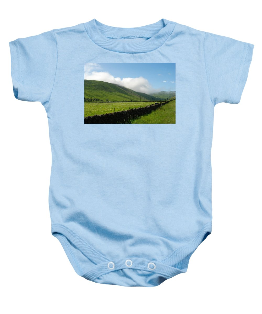 Hills Baby Onesie featuring the photograph looking down Ettrick valley in Selkirkshire in summer by Victor Lord Denovan