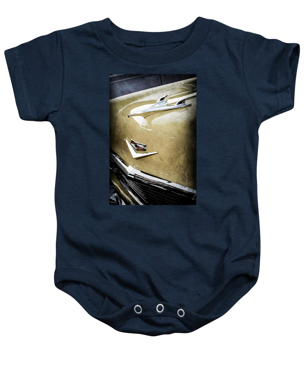 1956 Chevrolet Hood Ornament Baby Onesie featuring the photograph 1956 Chevrolet Hood Ornament - Emblem by Jill Reger
