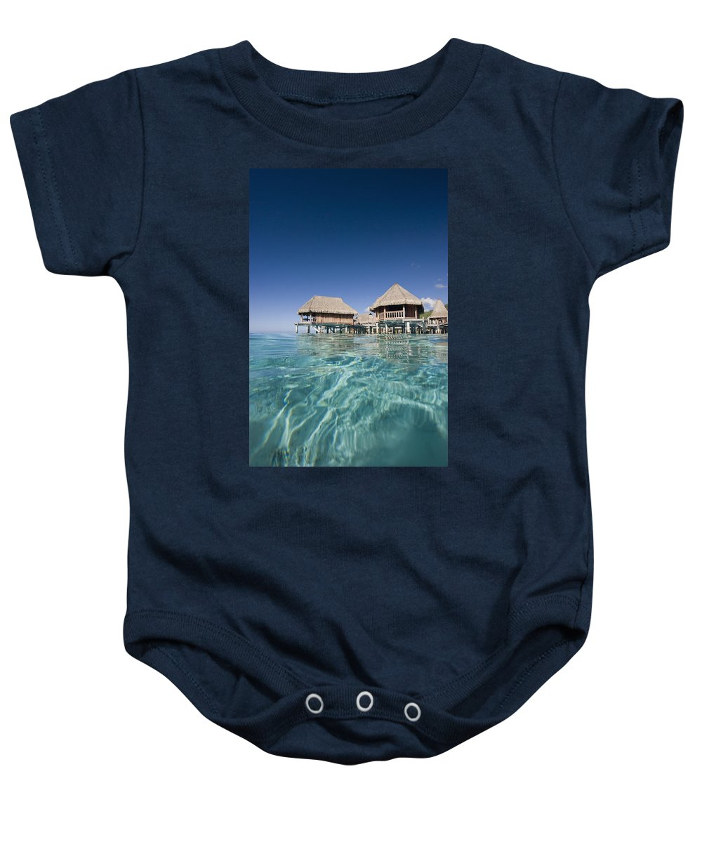 Above Baby Onesie featuring the photograph Bungalows Over Ocean by M Swiet Productions
