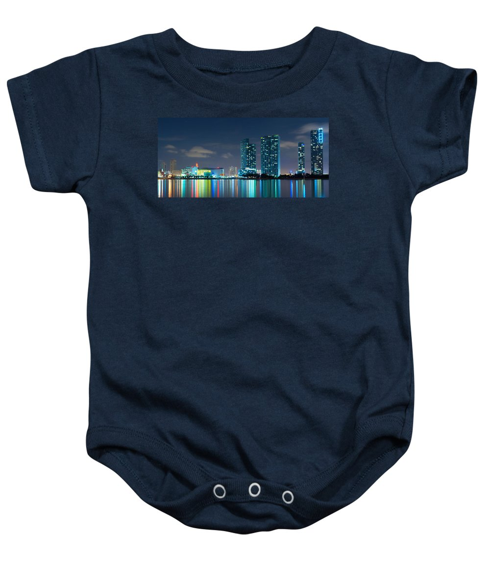 Aaa Baby Onesie featuring the photograph American Airlines Arena And Condominiums by Carsten Reisinger