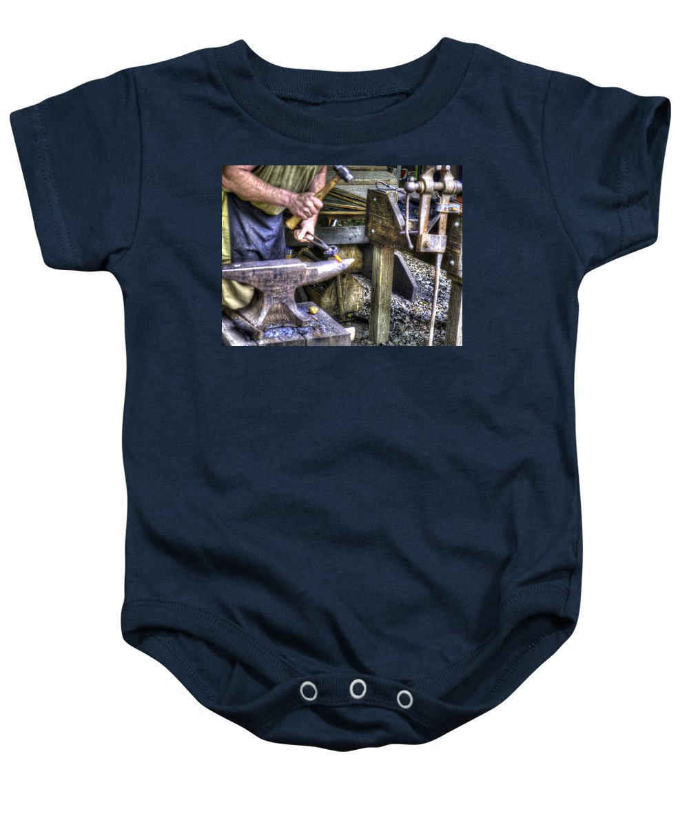 Forge Baby Onesie featuring the photograph Blacksmith Working Iron V1 by John Straton