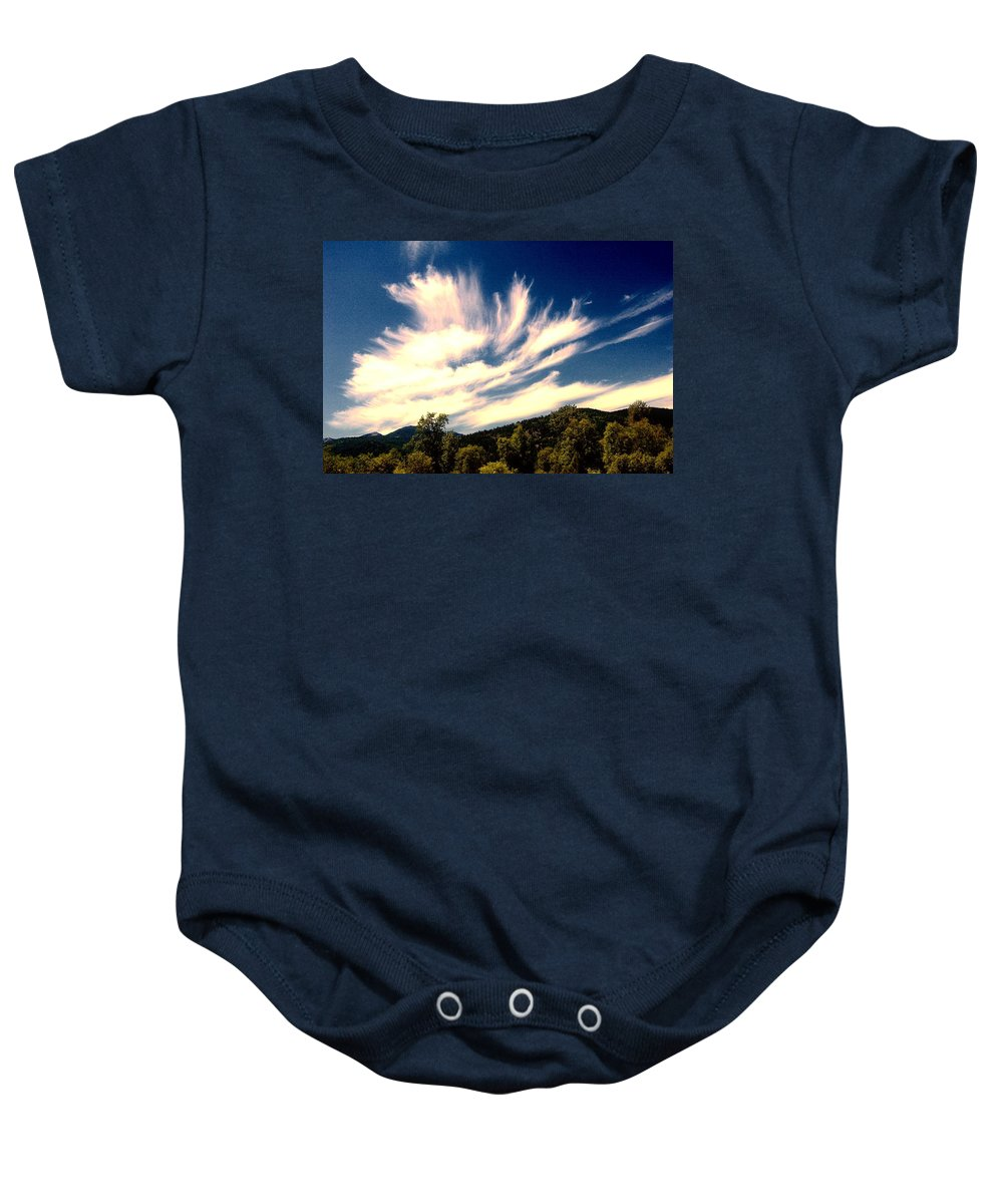 Clouds Baby Onesie featuring the photograph Clouds Over The Mountains by Jeff Swan