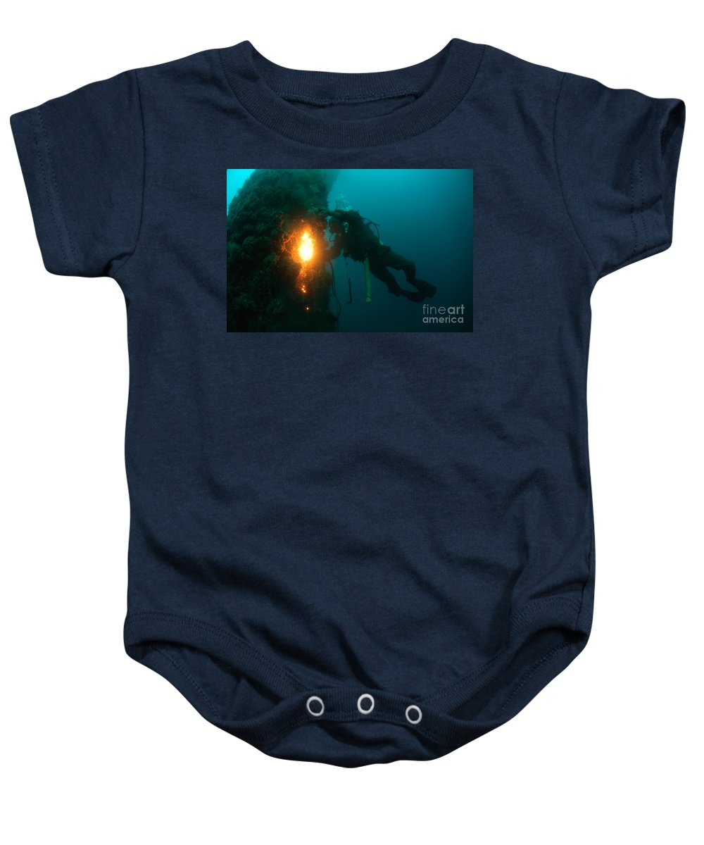 Commercial Diver Baby Onesie featuring the photograph Commercial Diver At Work by Hagai Nativ