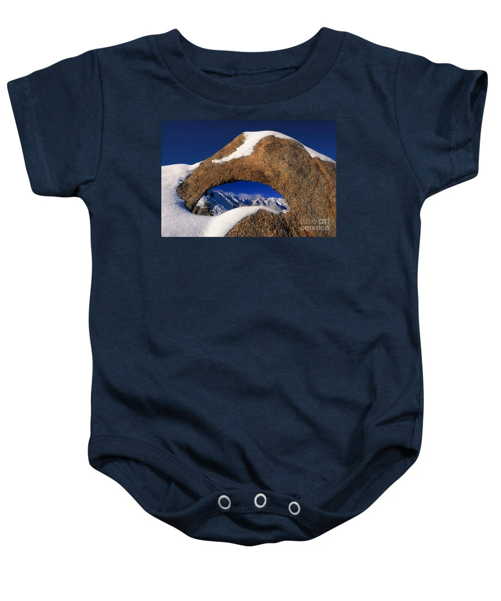North America Baby Onesie featuring the photograph Eastern Sierras Through Snow Covered Arch by Dave Welling